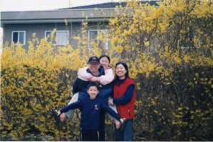 Dad, mom, bro and I (At the home parking lot in Canada)