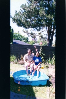 Dad and I cooling in the toy pool. (In the backyard of our home in Canada.)