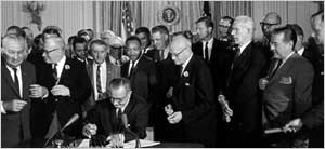 <a href=http://www1.cuny.edu/portal_ur/content/voting_cal/photos/lyndon_baines.jpg>LBJ signing the Civil Rights Act</a>