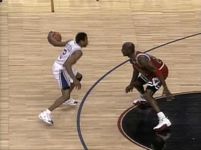 Allen Iverson crossing up Michael Jordan (http://img455.imageshack.us/img455/1609/aicrossmj8kh.jpg)