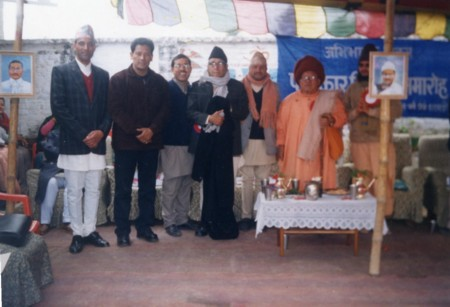 Swamiji is wearing yellow robe (from school file)
