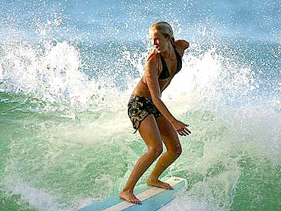 <a href=https://www.ci.huntington-beach.ca.us/Residents/News_Publications/Community_Connection/jun05/girl_surfer.jpg>Bethany</a> riding a wave during a competition