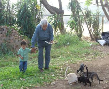 MY GRANDFATHER GIVING FOOD TO THE CATS (ON THE RANCH)