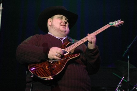 <a href=https://www.johnnyhiland.com/images/2_06/05.jpg>Johnny Hiland playing at the Winter NAMM festival </a>