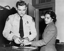 This is a shot of Rosa Parks being fingerprinted. (http://en.wikipedia.org/wiki/Rosa_Parks)