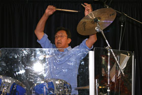 Band leader John Tu on drums