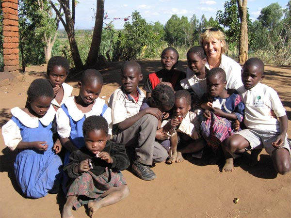 Wendy Milette with children in Manola Village, Malawi Africa 2006